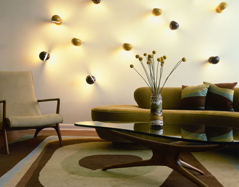 Luxury-cozy-living-room-design-with-modern-sofa-armchair-oval-coffee-table-wall-decoration-and-carpet