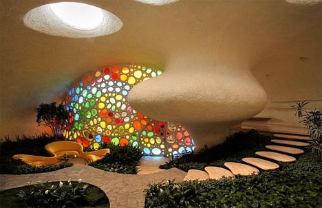 Creative Colorful Curved Spiral Shell House Design dornob from dornob.com
