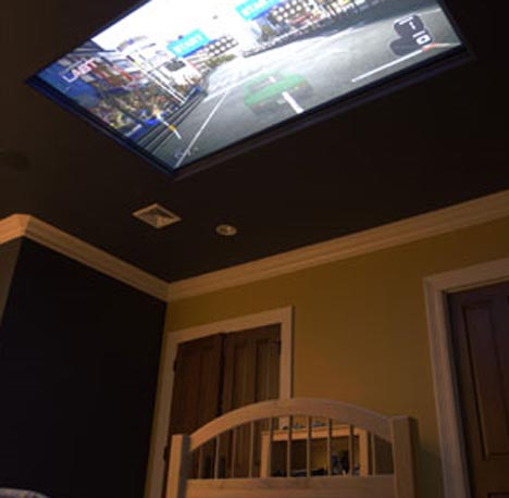 Home of Cool: Kids Bedroom Design with 100″ Ceiling TV