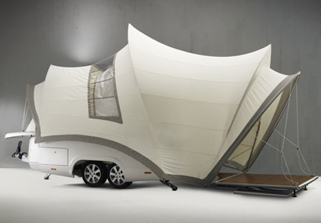 Tiny Camper Trailer Converts Into Huge Mobile Motorhome
