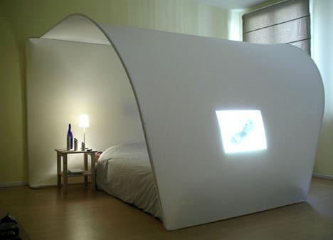 ... Beds With Built In TV  A length of white fabric is stretched between  bendable side supports, providing a balance of