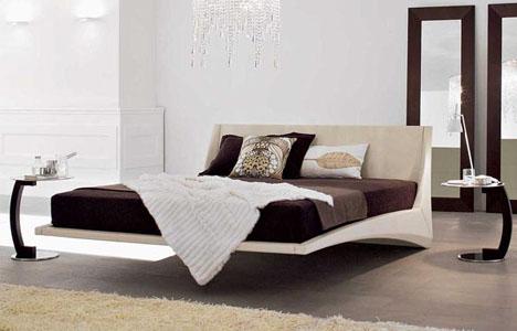 designad säng som svävar