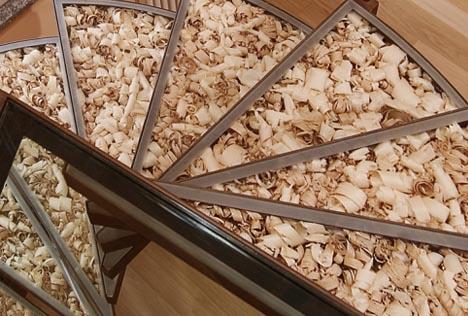 elegant steel spiral staircase reuses scrap wood shavings