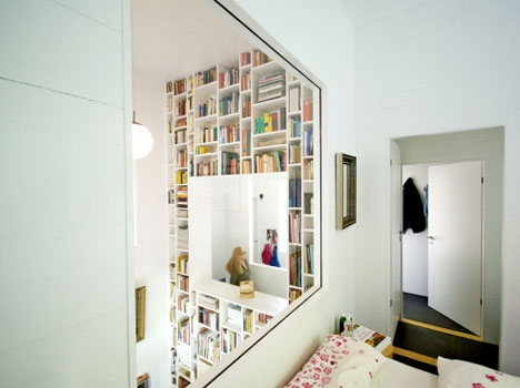 Charming High Volumes: Huge Home Bookcase Spans Multiple Stories