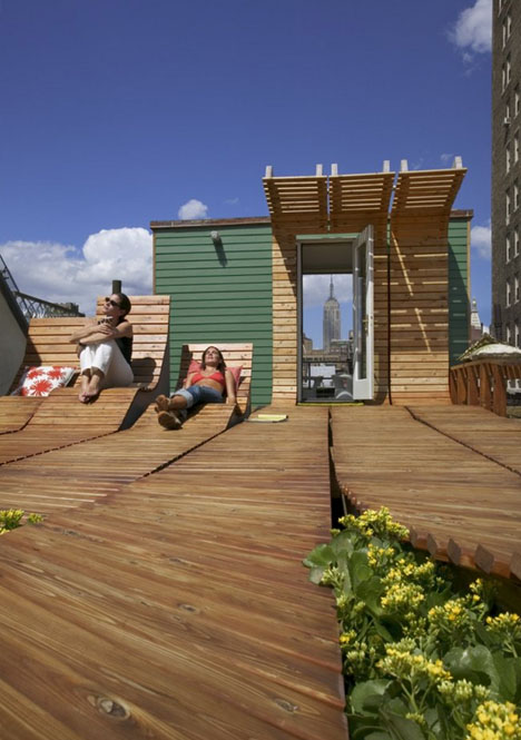 Roll-Up Rooftop: Daring Rounded-Wood Deck Design in NYC on log cabin decks, log house railings, log house vinyl siding, log house landscaping, rustic log decks, log homes, log house roofs, log house boats, log decks and porches, log house shutters, log house stucco, log house trailer, log house hot tubs, log house patio, log house cabins, log house masonry, log house cleaning, log house stairways, log house windows, log house pool,