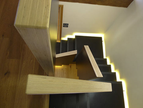 Squared spiral winding modern staircase floats on light for Square spiral staircase plans
