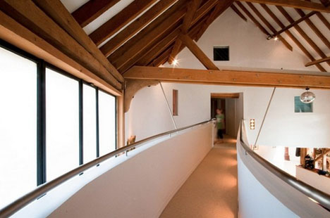 Swooping Curves Transform Old English Barn To New Home