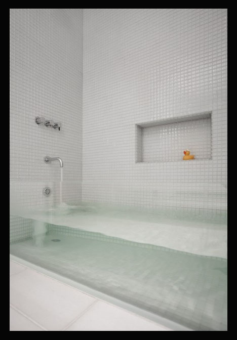 Glass Bathtub invisible bathtub: ultra-thin glass tub in rowhouse refab