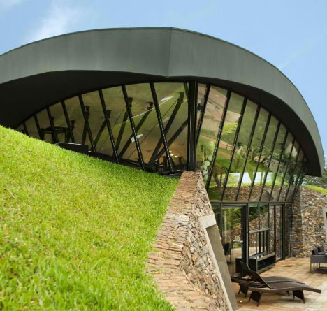 Modern earth shelter homes built into the hillside for Earth sheltered structures