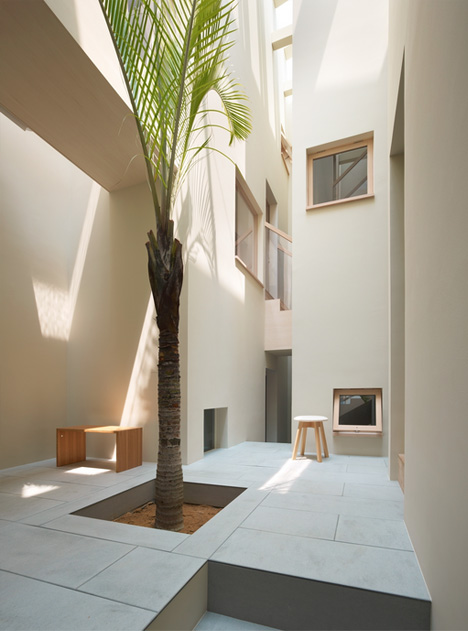 Slim Corridors & Courtyard Open Up Narrow Japanese Home