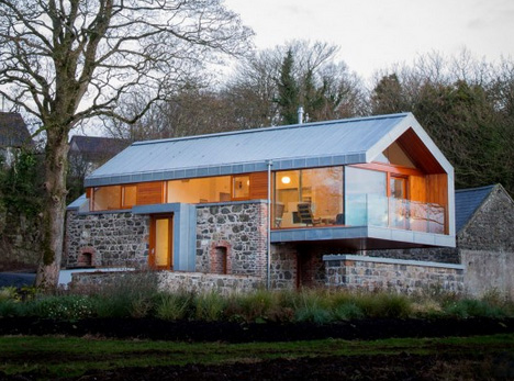 Cobbled With Copper Stone Barn Wall Built Into New Home