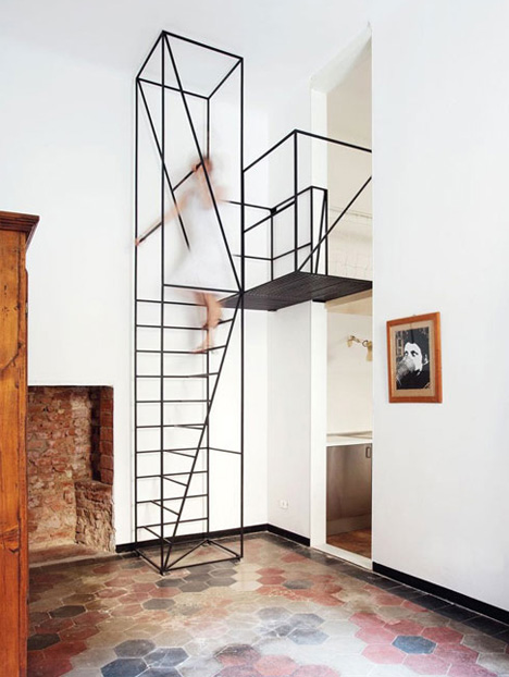 Minimalist Black Metal Staircase Stands Out in White Room