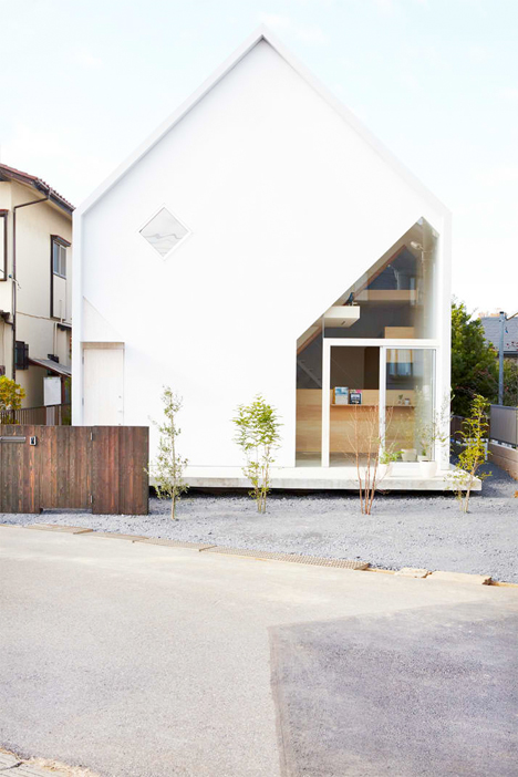 Stark Simple House Conceals Bright, Complex Interiors