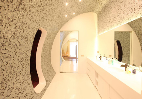 curved lighted space age bathroom