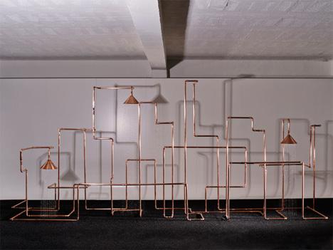 front shower copper sculpture