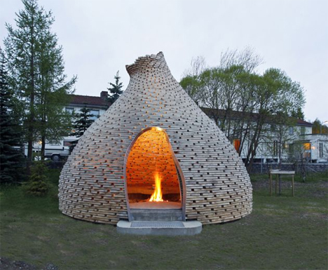 Cozy outdoor fireplace hut is a warm glowing play place solutioingenieria Images