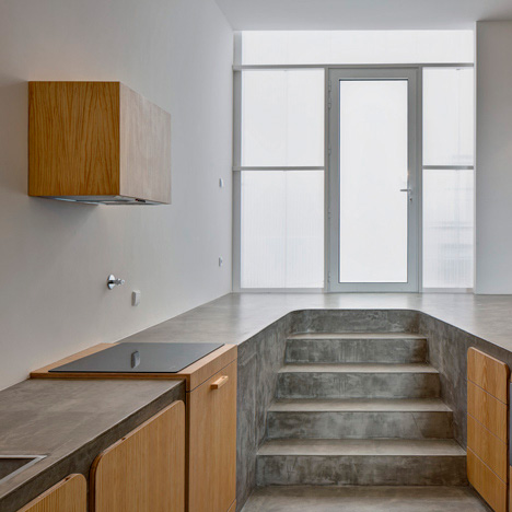 Concrete Floor Beautifully Doubles as Kitchen Counter