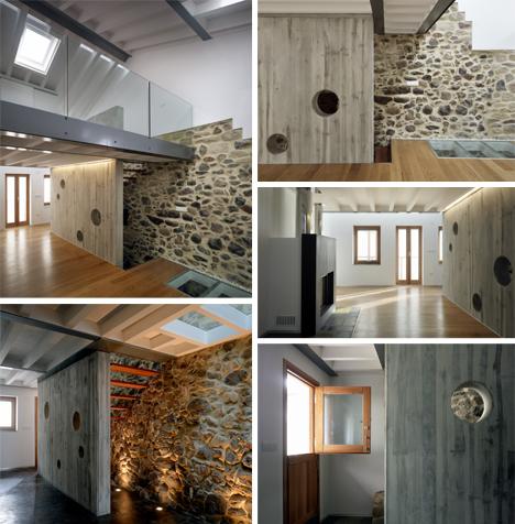 living area stone wall glass catwalk