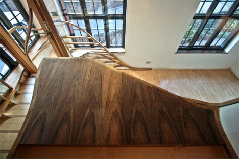organic tree-like winding wooden stairs