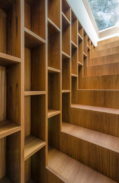 stairs extending from bookcase - Staircase + Bookcase = Warm Functional Storage Area