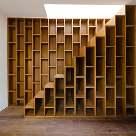 - Staircase + Bookcase = Warm Functional Storage Area