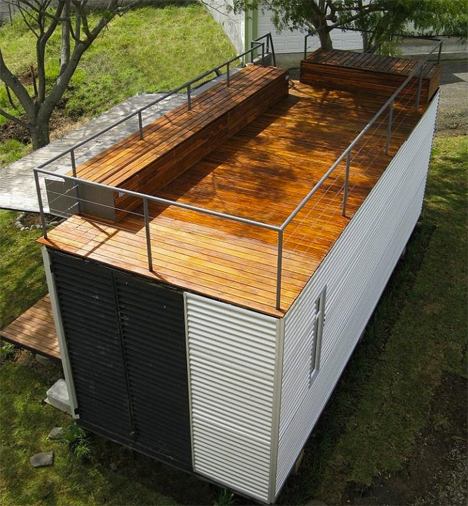 Tiny Glass Walled Container Home Features Rooftop Deck