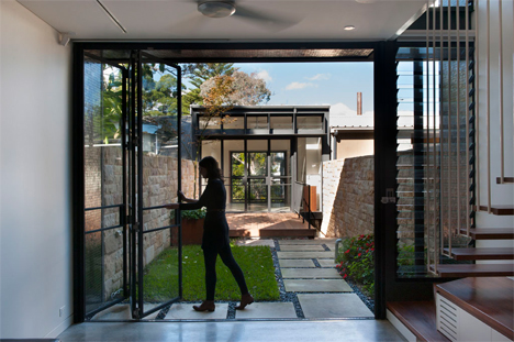 glass doors opening to courtyard & Upside Down and Backward: Unusual Home With Airy Features