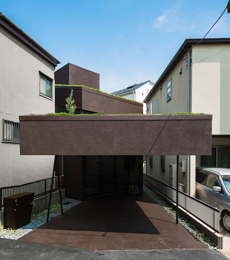 overhanging green roof cave house