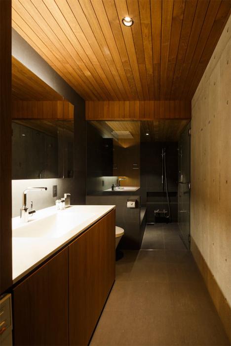 Concrete + Teak + Glass = Sophisticated Minimalist Home