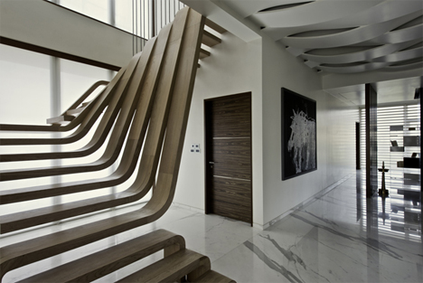 mumbai sculptural wooden curved treads staircase