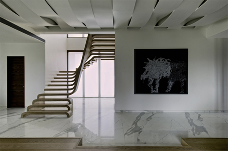 sculptural curved tread wooden staircase