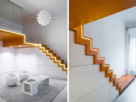 Angular Insert Adds Dual Staircases To Apartment Interior