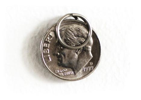 pon holding a dime