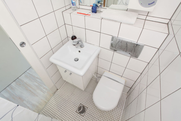 Smart Design Packs A Whole Apartment Into 140 Square Feet Clic Modern Wet Room Small