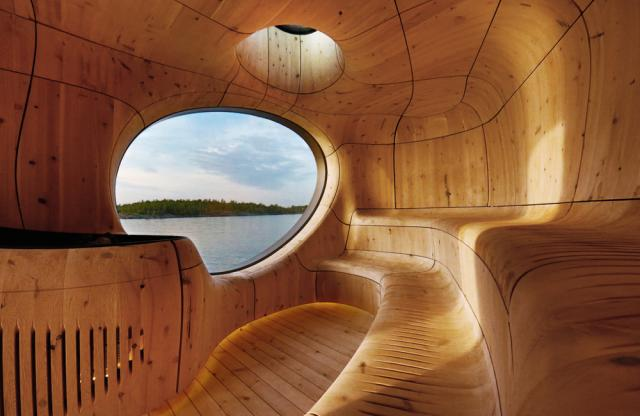 The beautifully intimate and curvy interior of the Grotto Sauna by Partisans