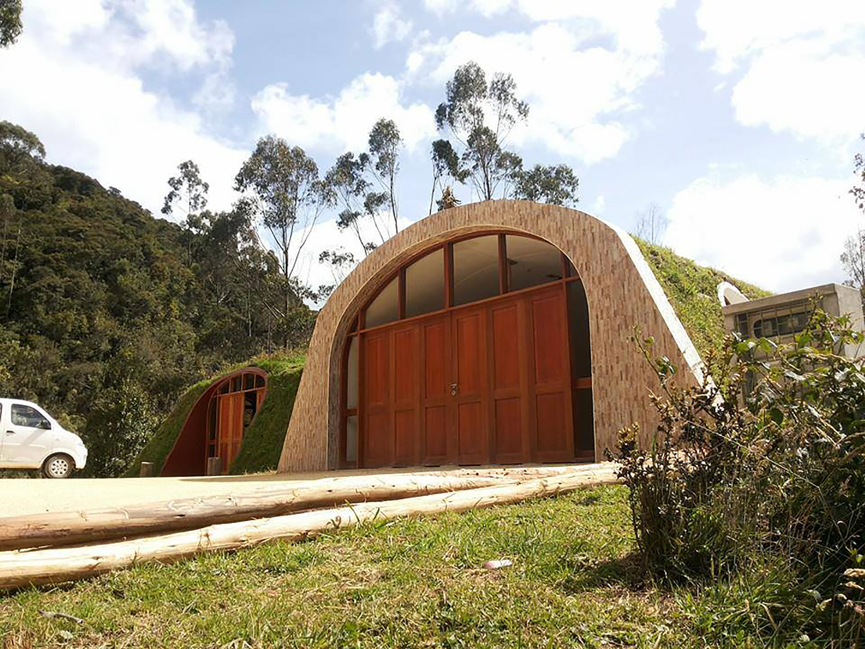 A hobbit home of your own hilly grass covered prefabs for Earth covered homes