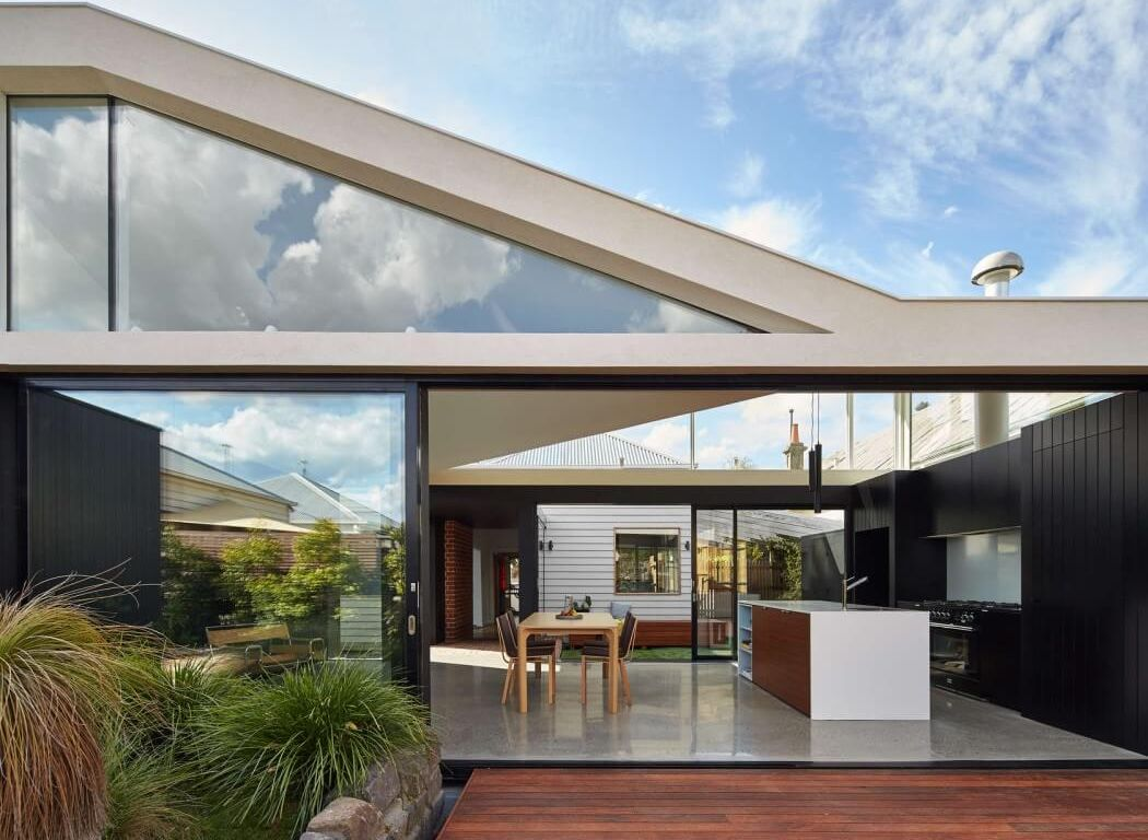 tunnel house glass volume links cottage with new addition