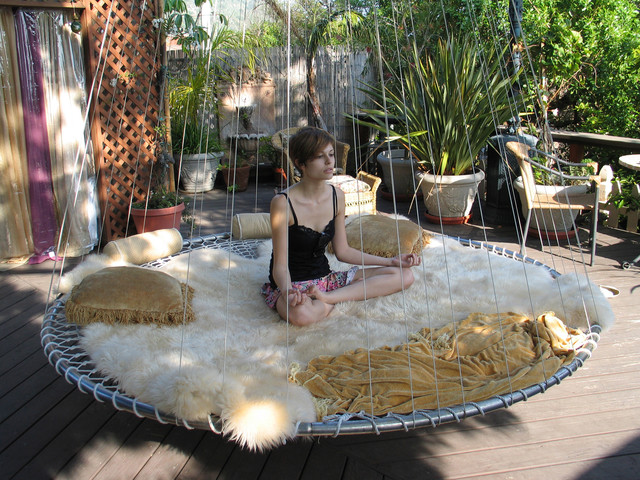 Outdoor Floating Bed dream bed: hammocks meet round mattresses in this hanging design