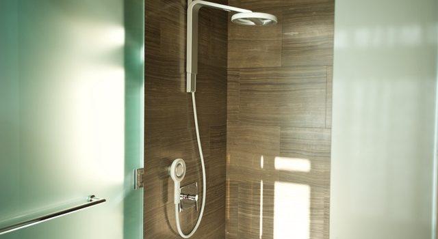 nebia showerhead in bathroom
