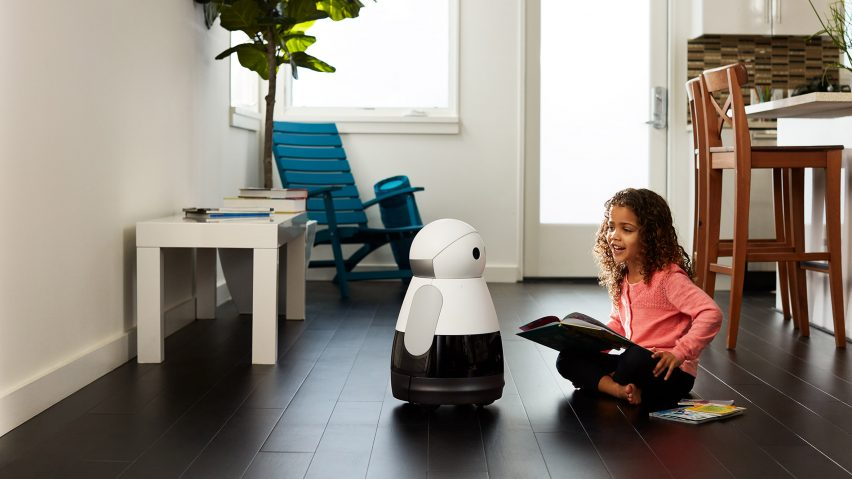 kuri home robot and child