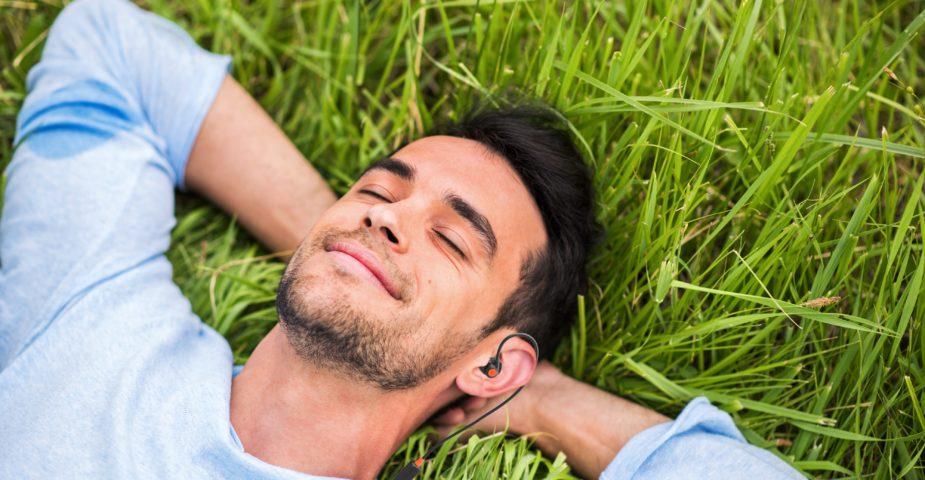 man wearing earmade lying down