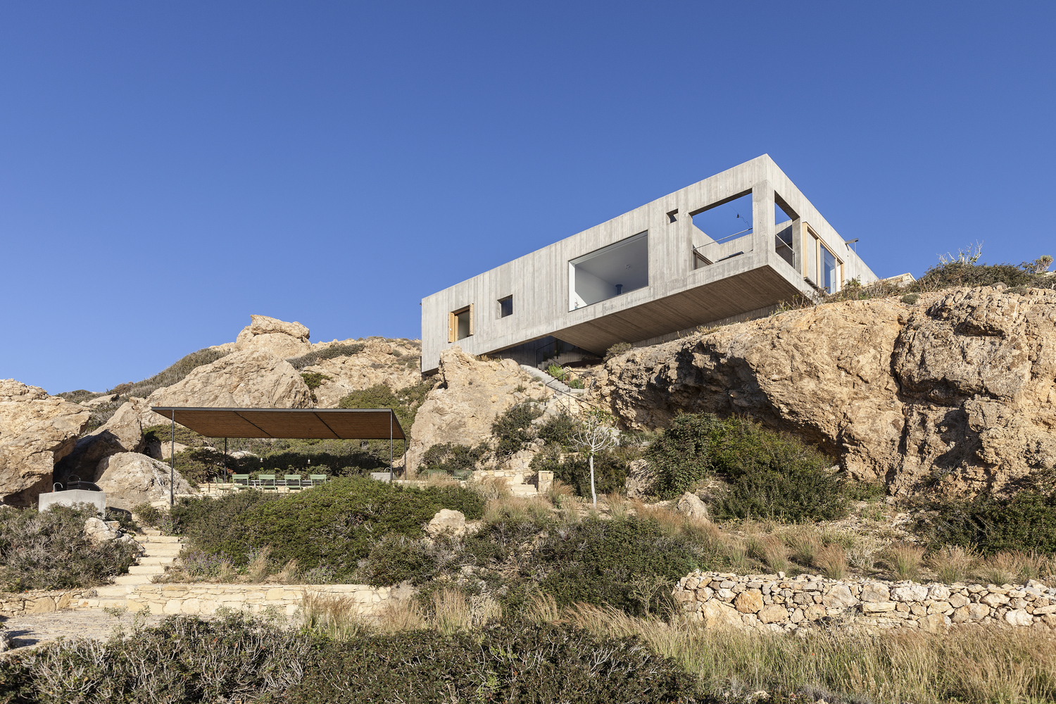 Floating Concrete: A Breezy Cantilevered Cliffside House in Greece