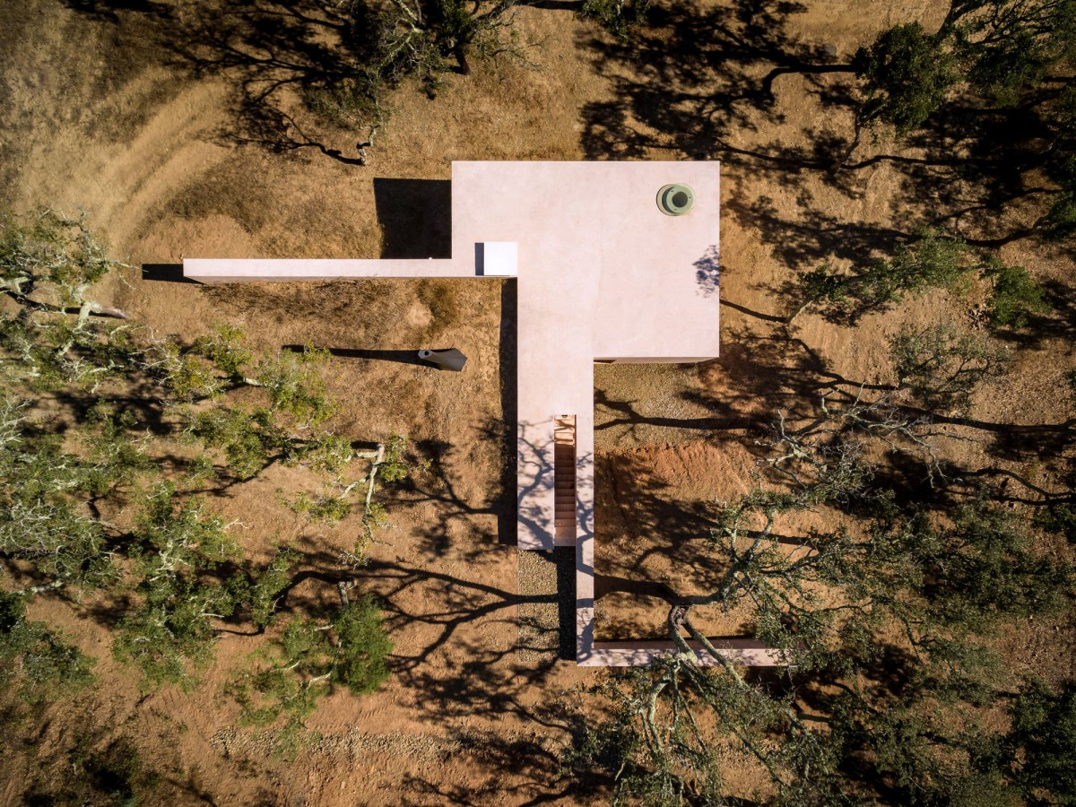 Earth-Sheltered Pink House in Portugal Looks Like a Modernist Sculpture